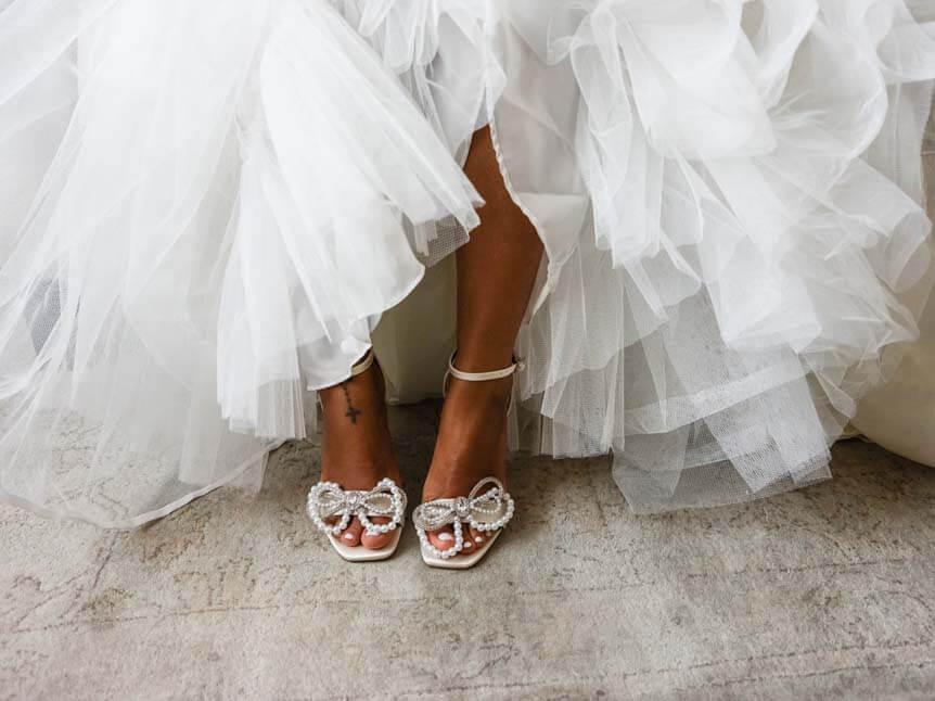 Bride's feet beneath flowing dress